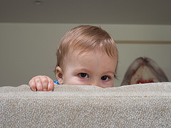 Hiding behind the couch, from Flickr Creative Commons user Taylor Brigode: https://www.flickr.com/photos/taylorlb/9110126712/in/photostream/