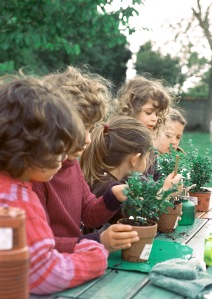 Children with potted plants